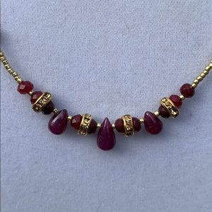 Ruby and crystal necklace .